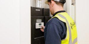 Engineer setting energy meter